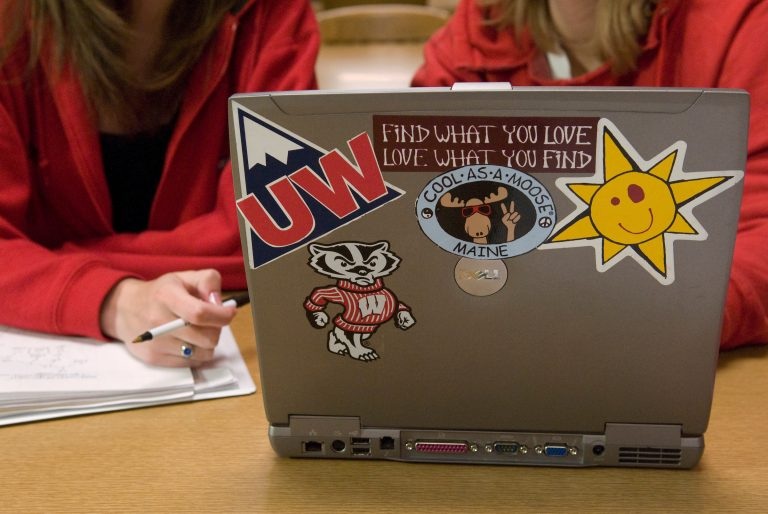 Student laptop with various UW stickers