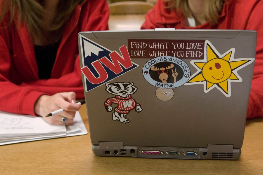 Student laptop with various UW stickers