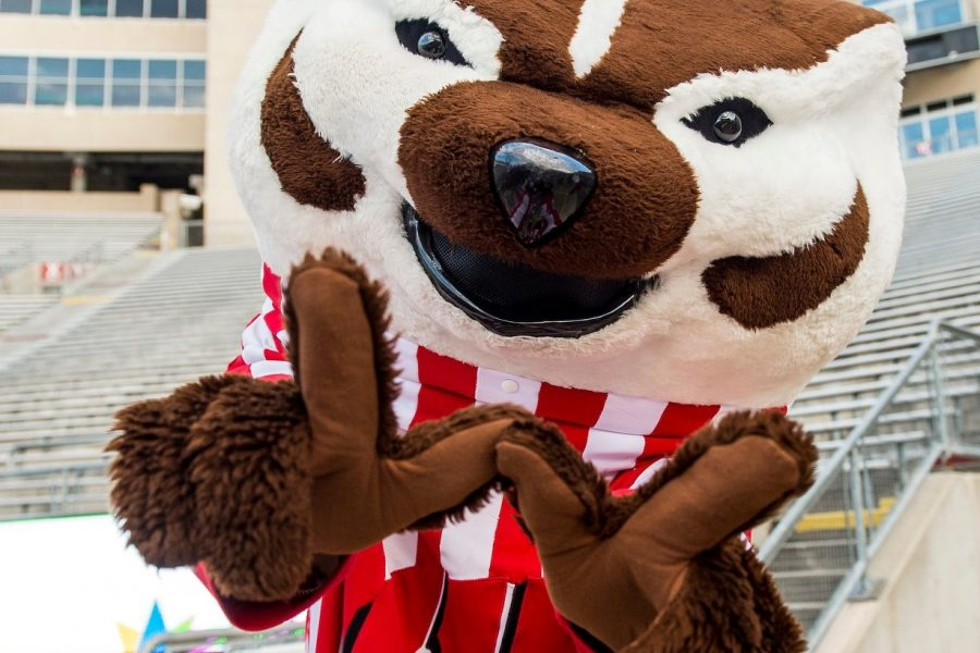 Bucky Badger throws the W handsign